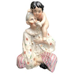 Early 19th Century Staffordshire Porcelain Figure of Boy on Woman's Shoulder