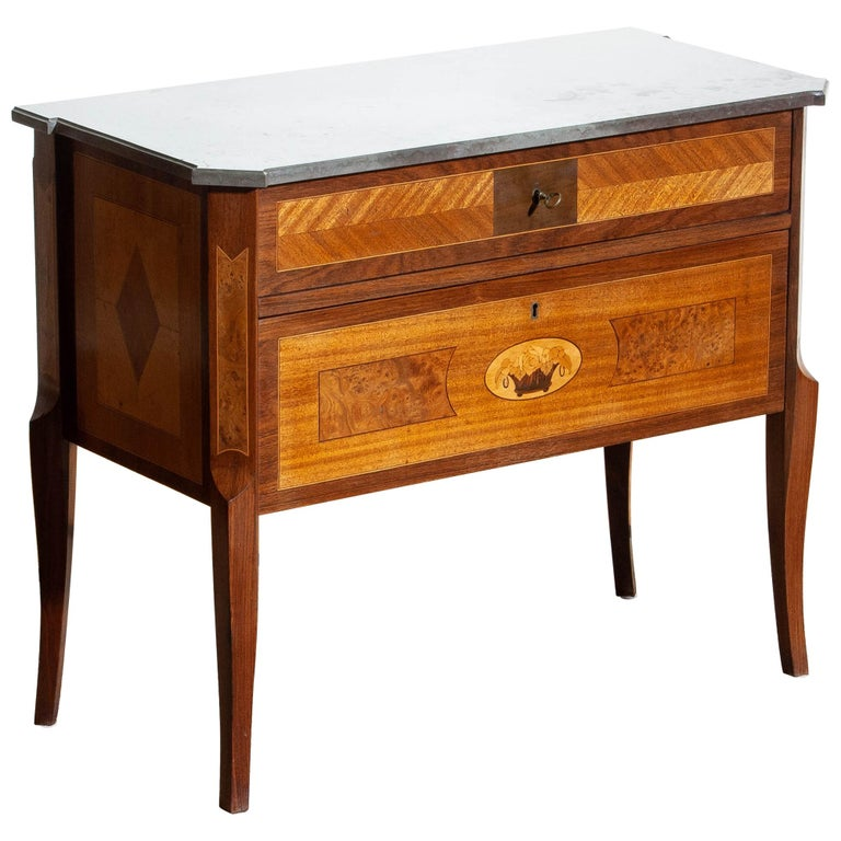 Beautiful commode with large selection of wood craft techniques using mahogany, walnut, birch and various fruitwoods with a Kolmarden top.