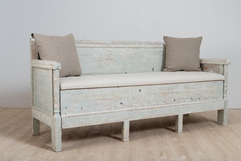 Gustavian Provincial sofa from northern Sweden. The sofa is hand scraped to the original light blue / green paint. Decorated with carved wooden decor over the back and lower section. 