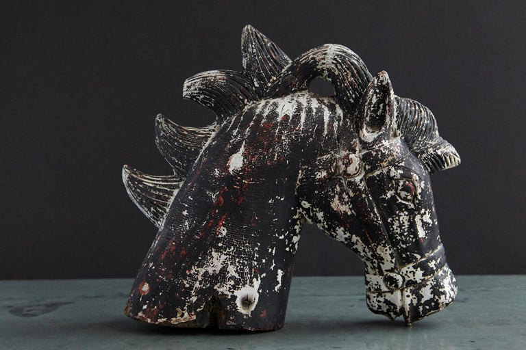Great looking hand carved and painted massive wooden horse head, late 19th century, probably from a small carousel or children's toy. Very nice patina through peeling paint and wear.