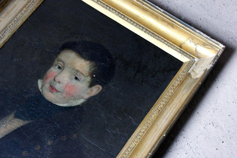 The Irish school depiction of a smart young boy in oils on board, of around eight to ten of years of age, shown in bust length, presented in its original deep moulded gilded frame, the sitter with green eyes, rosy cheeks and a sweet smile, wearing