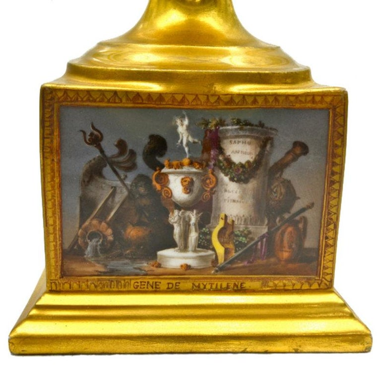 A museum quality early 19th century Paris porcelain urn. The twin handled vase sits on a rectangular porcelain base (modelled as part of the vase), which is decorated on all four sides with finely painted scenes titled 'Gene de Corrinte', 'Gene de