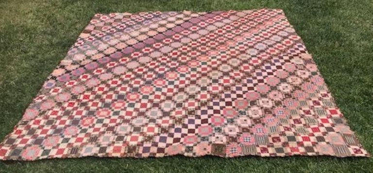 Early 19th century mini pieced nine patch quilt on the diagonal. This amazing quilt is in such pristine condition with minor age spots that are not noticed at first glance. The spots are so minor and do not detract from its historic beauty. This