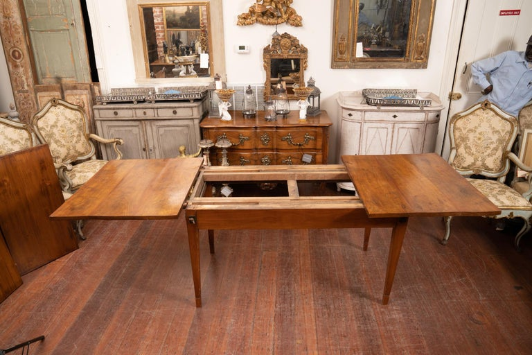 Simply elegant Italian Directoire extension dining table including two solid walnut extension leaves perfectly matched to the table.