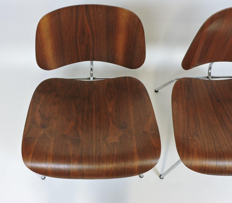 Hard to find pair of early LCM chairs designed by Charles and Ray Eames and manufactured in the 1940s by Evans Products Company. These chairs are in very good condition with minor wear, possible repairs to some shock mounts and good, original