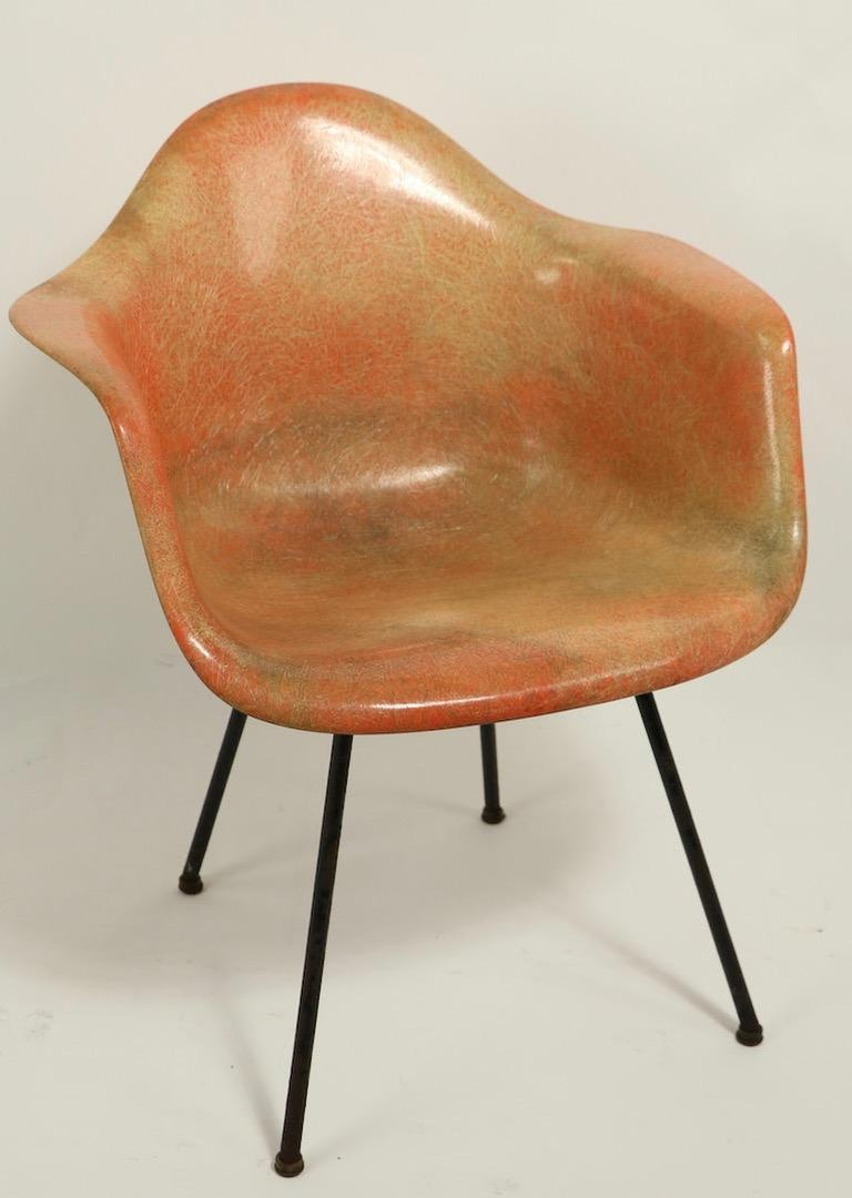 Rare 1st generation Eames rope edge fiberglass SAX chair in translucent fiberglass, having the large rubber bumpers, X base, and domes of silence glide feet. The chair shows significant discoloration, but no cracks, chips, or structural damage. It