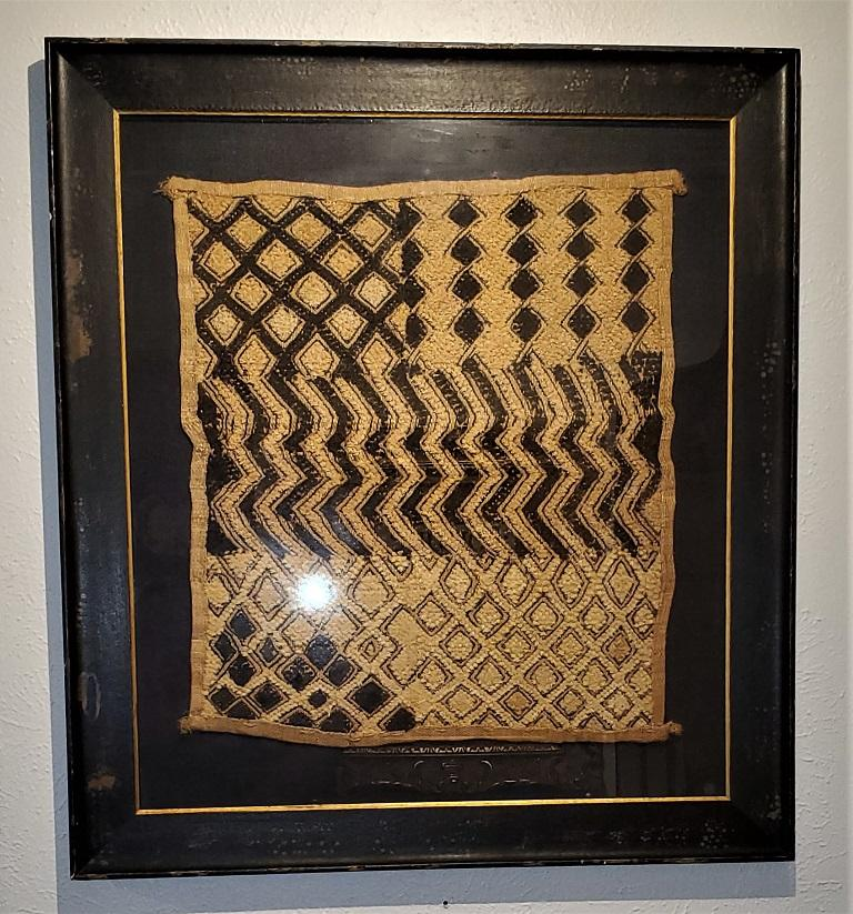 Presenting a gorgeous piece of West African Tribal Art, namely an early 20th century Congolese kuba framed textile.  Made in the Congo by the Kuba People (who are famous for their beautiful textiles), circa 1920.  The frame is more modern and