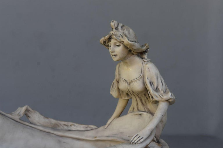 Fruit bowl with Art Nouveau naiads in Royal Dux porcelain circa 1900. The head of a naiad has been glued.