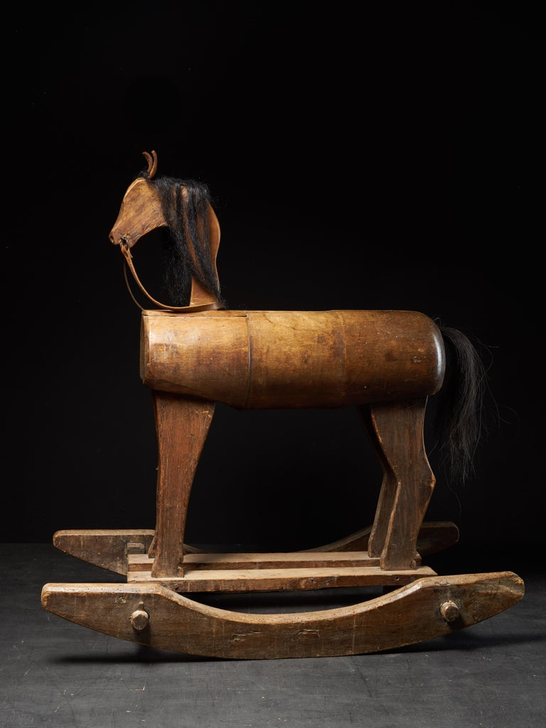 The rocking horse was made in the first half of the 20th century in the United Kingdom. The ears and the reigns are in light brown leather. The main and the tail of the horse are made of real hair and the body, the legs and the bottom part are made
