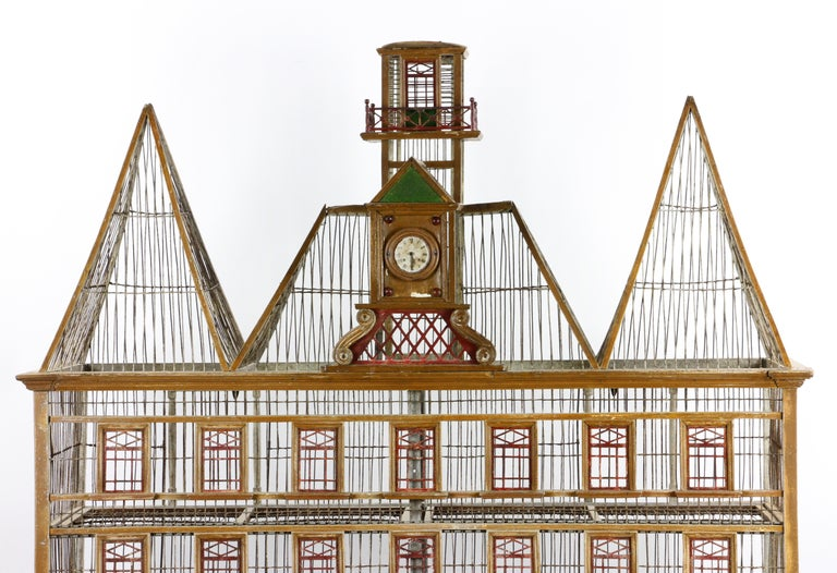 Rare early 20th century. French two-level bird house made of wood, wire, and metal, two levels, with clock face marked