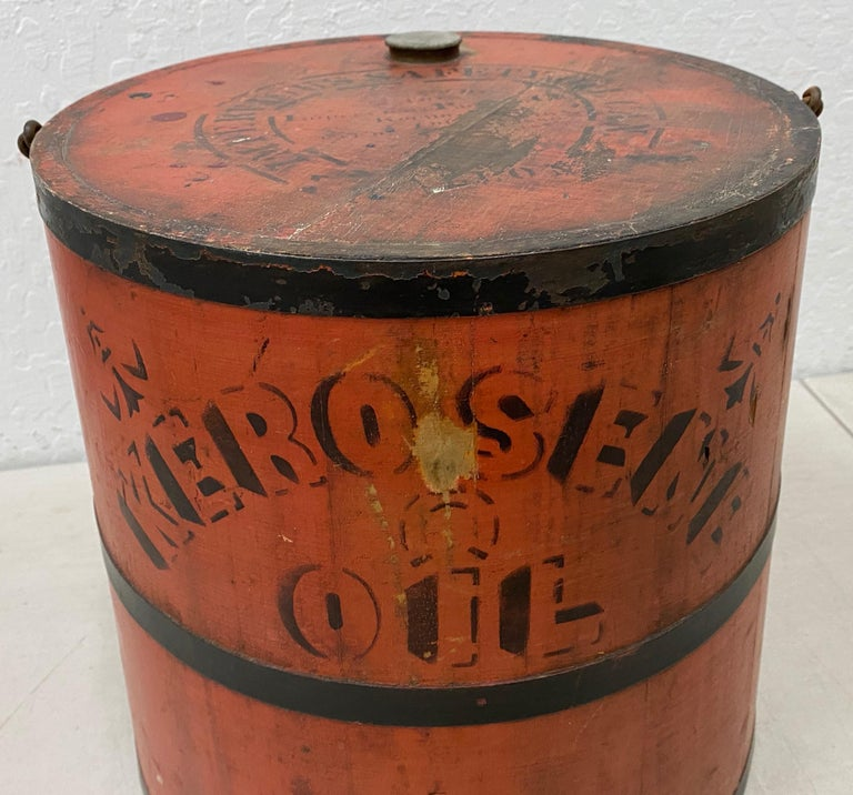 Early 20th century red stenciled kerosene oil can  Fantastic old school wooden and metal strap hand made kerosene oil can.  Though we don't use the cans today, kerosene lamps were in most every household in America in the 19th and early 20th