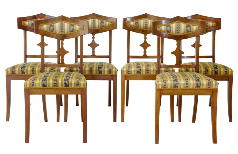 Large suite of furniture consisting of one sofa, four armchairs, six single chairs and two stools, circa 1910.
