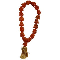 Early 20th Century Amber Statement Necklace with Smiling Buddha Heads