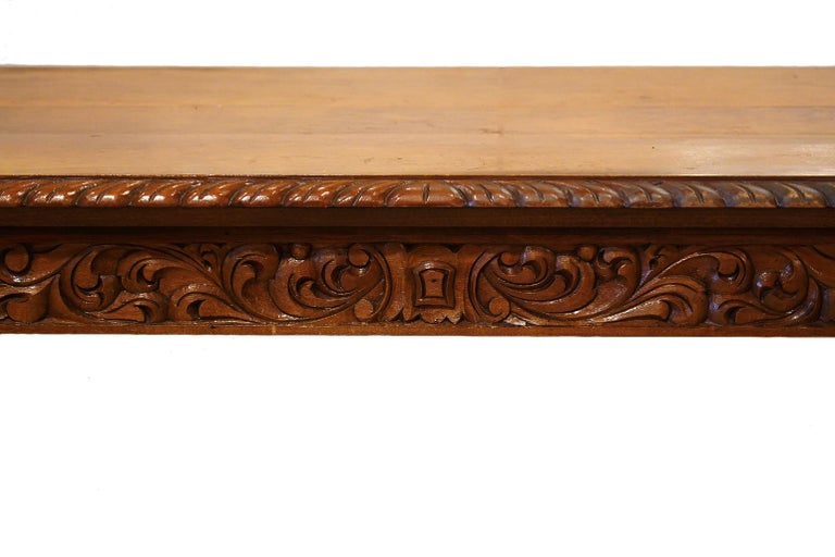 This elaborately carved Baroque style library or center table is a feast for the eyes. Well-crafted carvings cover almost all of the surfaces adding an almost sculptural effect.