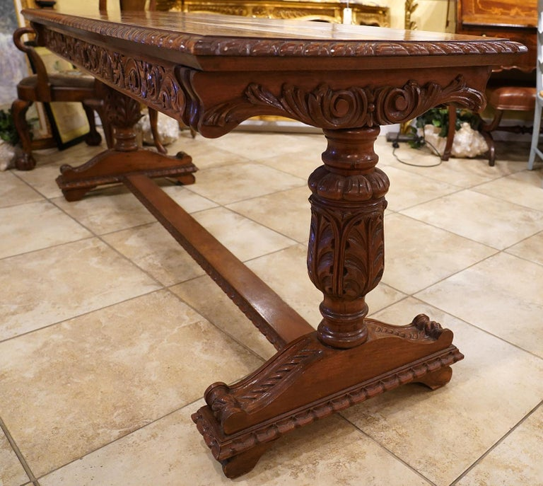 Early 20th Century American Carved Walnut Threstle Base Library or Center Table In Good Condition For Sale In Ft. Lauderdale, FL