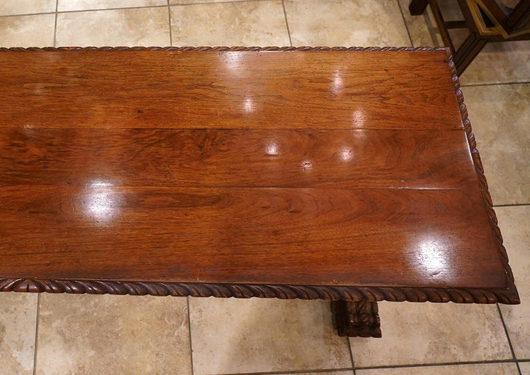 Early 20th Century American Carved Walnut Threstle Base Library or Center Table For Sale 1