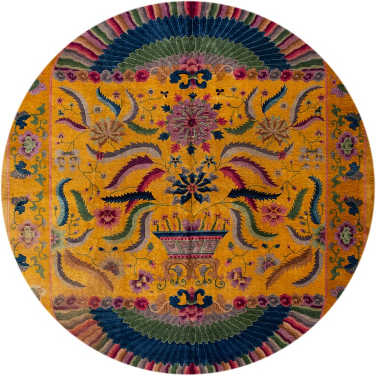 Beautiful antique Chinese Art Deco rug circa 1920, hand knotted wool with a golden yellow field, multicolor accents in an all-over design. This rug measures 10' 1