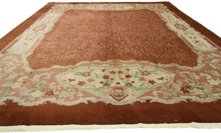 70603, early 20th century antique Chinese Art Deco rug. Inject a little deco color into your home with this early 20th century Chinese Art Deco rug. A vibrant fusion of the rustic burnt umber background filled with an allover vine pattern surrounded