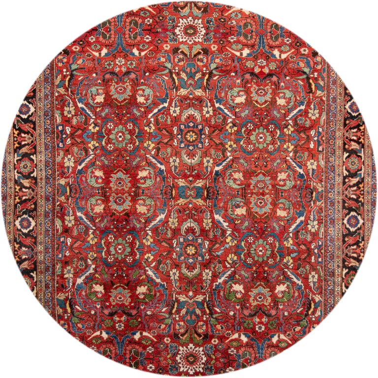Beautiful antique oversize Mahal rug, hand knotted wool with a red field, ivory and blue accents in an all-over Classic motif, circa 1920.