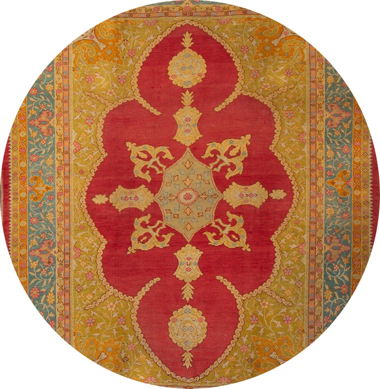 Beautiful antique Turkish Oushak rug, hand knotted wool with a yellow field, multi-color accents in an all-over medallion design, This rug measures 8' 10