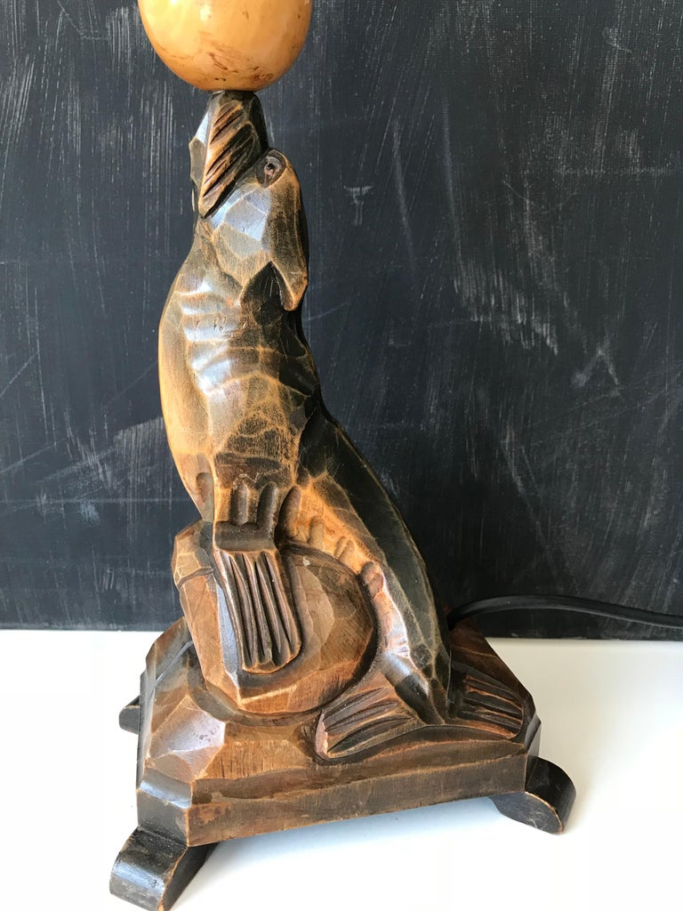 European Early 20th Century Art Deco Hand Carved Wooden Seal, Sea Lion Table or Desk Lamp For Sale