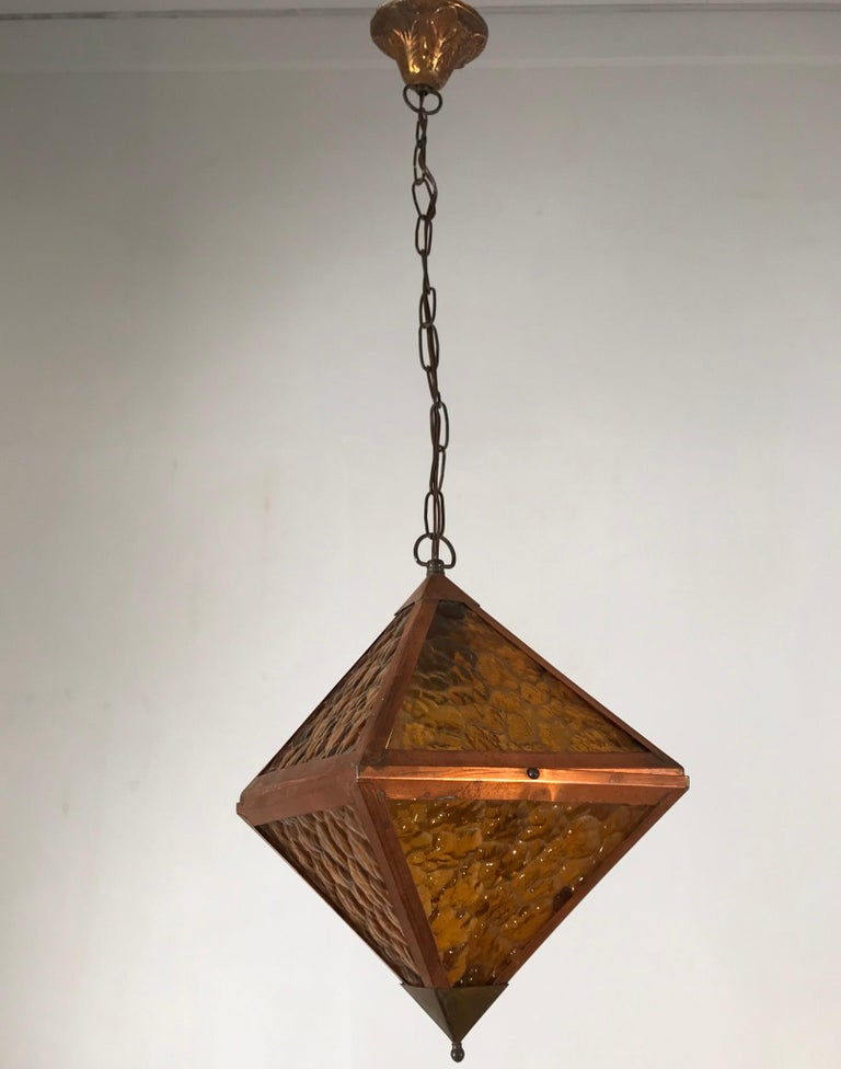 Rare shape, copper frame pendant with orange colored glass.  If you are looking for a unique Arts & Crafts pendant to grace your hallway, bedroom or perhaps a landing then this all handcrafted specimen could be perfect for you. The handmade, cubical