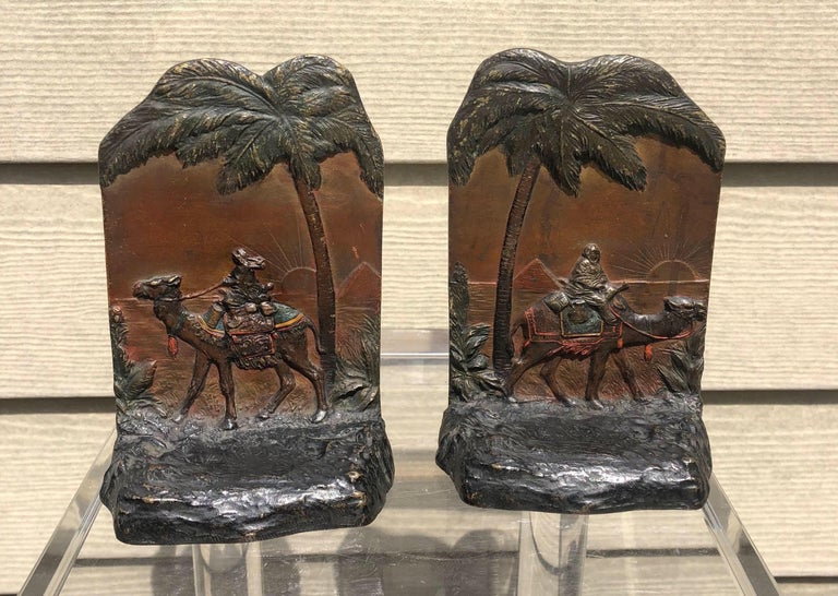 Beautiful early 20th century Austrian cold painted polychrome bookends depicting Egyptian pyramids, palm trees and camelback trader. Fantastic quality and patina.