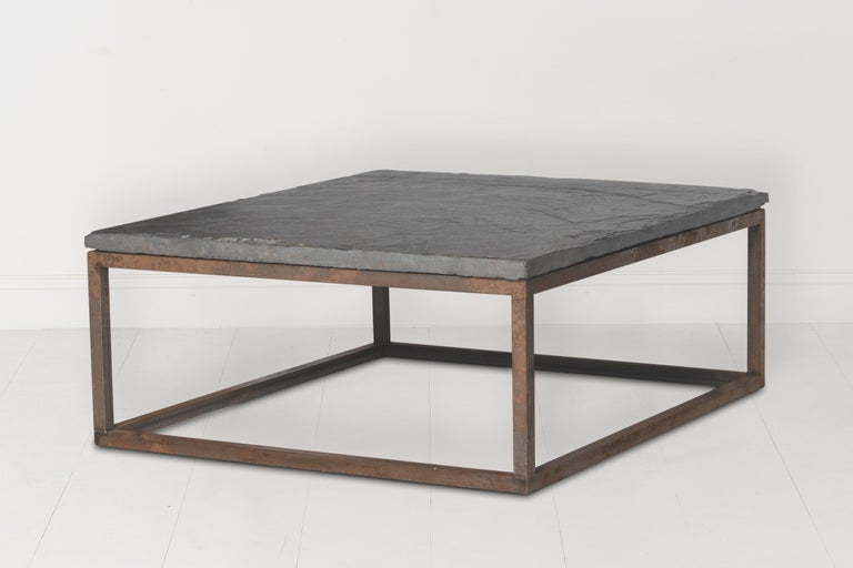 An unusually thick piece of circa 1920s Belgian slate sits atop a custom iron coffee table base. Found in Belgium. The slate top is 2.44 inches thick.
