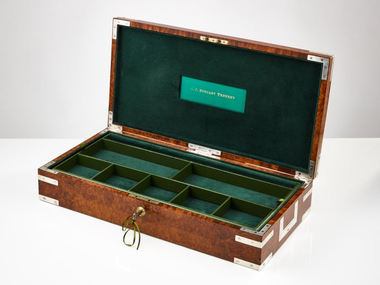 An early 20th century bird's-eye maple collectors box, circa 1920. Complete with recessed silvered handles and corners which gives it a military Campaign feel. This interior lining is in leather & suede in divided sections, the tray lifts out to