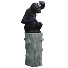 Early 20th Century Bronze Monkey Garden Statue on a Faux Bois Base