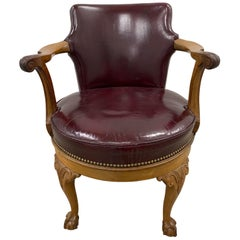 Early 20th Century Burgundy Leather and Carved Oak Swivel Chair, circa 1920