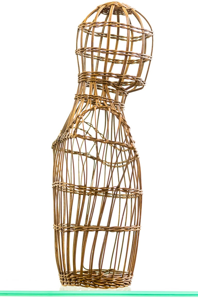 A truly lovely piece of design. This cane gentleman's bust mannequin was originally intended to be a shop display stand but it makes a wonderful piece of sculpture. The simple manufacture formed of steam bending the cane over a metal frame.