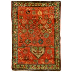 Early 20th Century Caucasian Bright Orange, Blue and Green Handmade Wool Rug