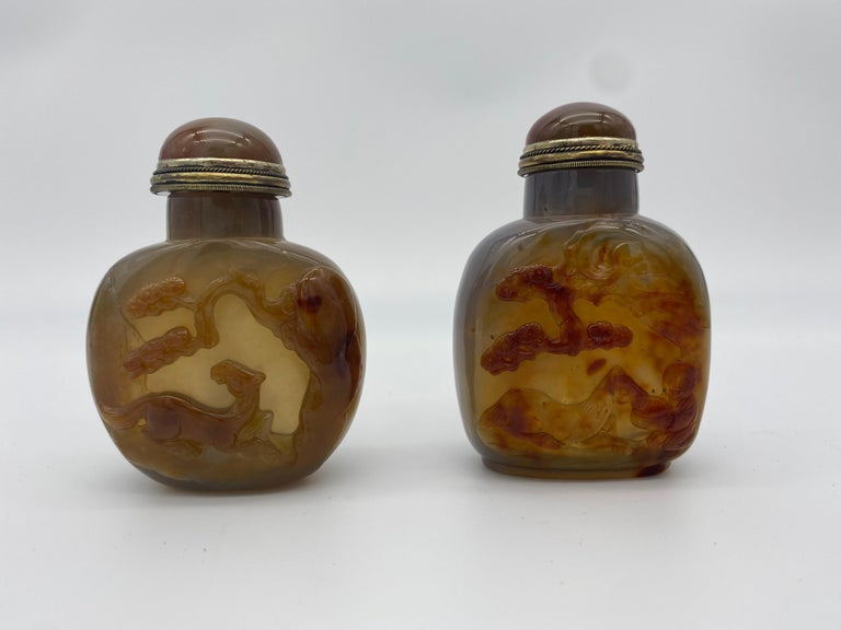 Early 20th century Chinese agate and jade snuff bottles from the Qing dynasty. 4 in total. Includes 2 exquisitely carved agate bottles (both 3 1/2