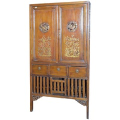 Early 20th Century Chinese Armoire with Gilt Motifs and Hand-Carved Medallions