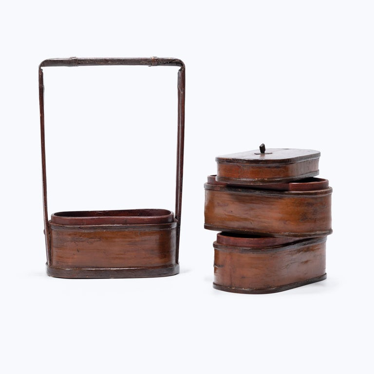 The basic form of this three-tiered box with handle has remained unchanged for a thousand years. Used like the modern lunchbox, each tier of this portable stacking box would have been filled with food and carried around by the handle. Unlike