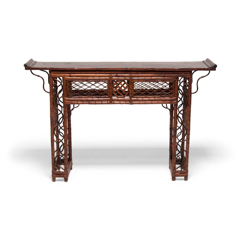The artisan who created this exquisite lattice altar table must have truly been a master of their craft. Constructed of carefully bent bamboo, the table has a straight, open frame patterned with intricate latticework. The abundant latticework