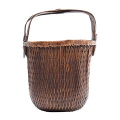 Early 20th Century Chinese Bent Handle Willow Basket