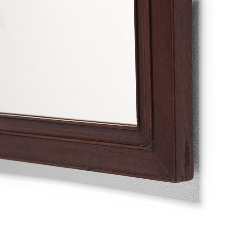 This early 20th century Chinese mitered rosewood mirror is carved with three continuous sinuous beads. With its rich color, fine grain, and smooth touch, rosewood is highly appreciated and sought after by collectors.
