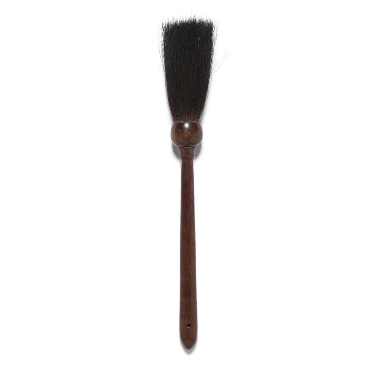 During the early 20th century Chinese scholar would have used this finely made calligraphy brush to write official documents or compose poetry. He would have held the handle upright in his hand—pressing down on the bristles to create heavier, bold