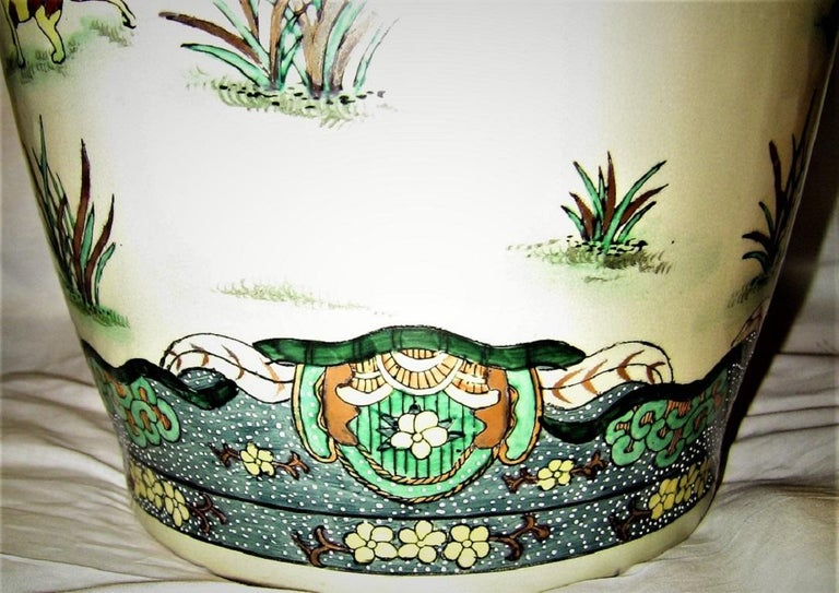 Presenting a very unusual and rare Chinese pottery set.  Early 20th century from circa 1920.  These pieces are in the style of 'Famile Rose' from Canton, with gilded foo dogs and raised and painted enameling, but, they are unlike anything I have
