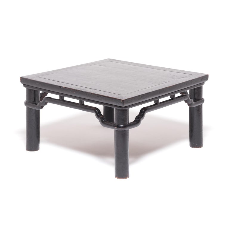 With its unusual proportions and low height, this early 20th century square table was an exciting discovery. Made by Qing-dynasty artisans in northern China, the table was constructed with round legs and a stepped humpback stretcher secured by