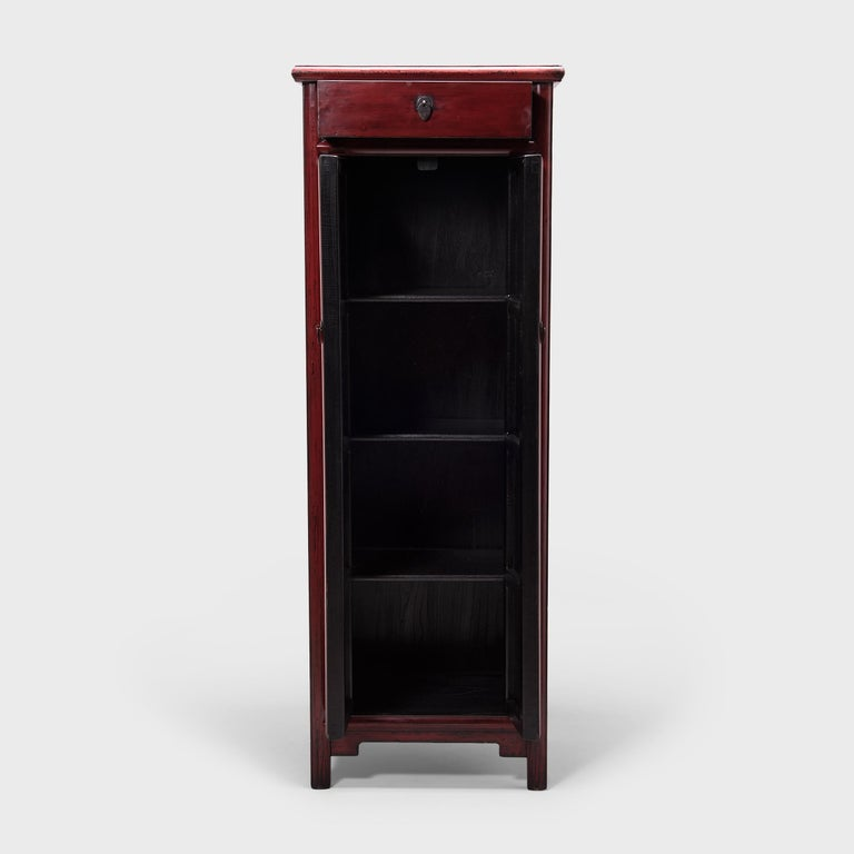 """Constructed in China's Hebei province, this early 20th century noodle cabinet is unusual for its tall, narrow stature. Known as a """"noodle cabinet"""" for the rounded wood molding that outlines its doors, the cabinet has a timeless design, with clean"""