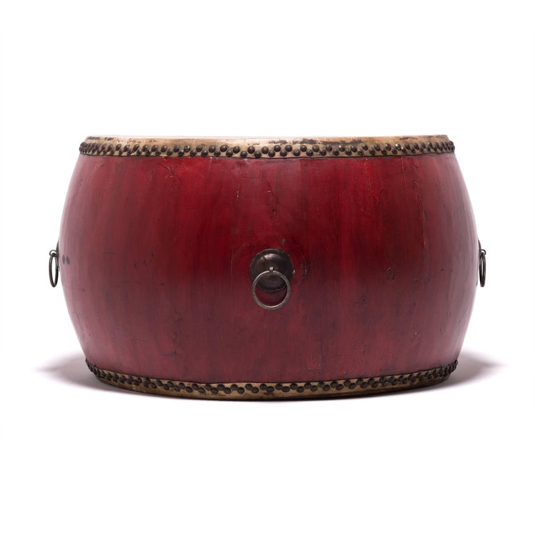 This monumental-scale drum makes no excuses for its commanding presence—both figuratively and literally. Its top is covered in natural hide and its handmade wooden base is finished in red lacquer, a hue which represents strength in Chinese culture.