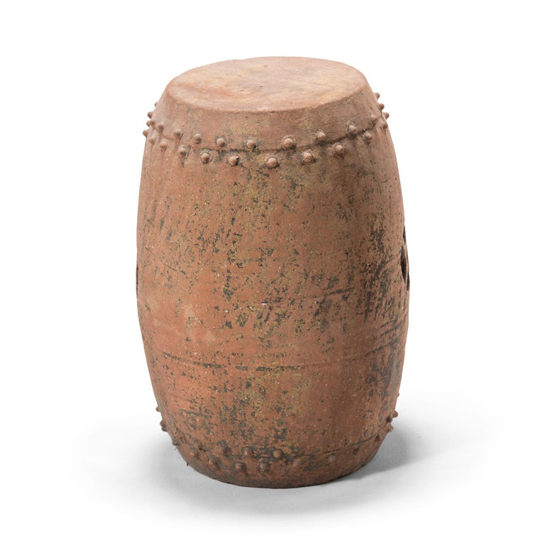 This early 20th century terracotta garden stool was created in Pingyao, an ancient, respected city in China's Shanxi province. With a history dating as far back as circa 800 B.C., Pingyao is widely known for its well-preserved Ming- and Qing-dynasty