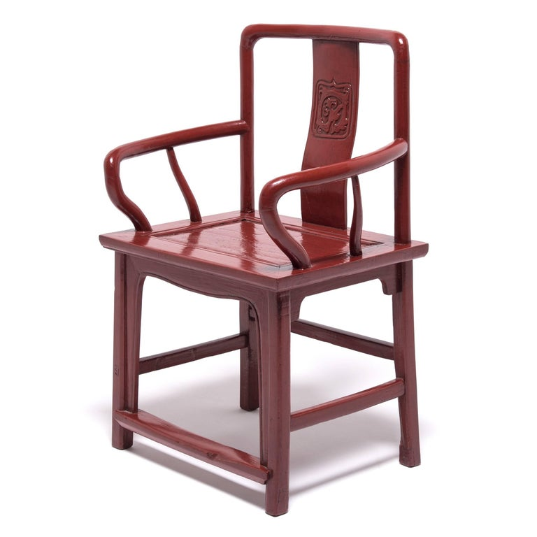 The defining characteristic of a Chinese Officials Chair is the way that the back crest rail turns continuously into the back posts. Our artisans lacquered this bold 19th century example from Northern China a big red, the color believed to bestow a