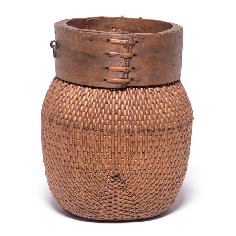 Centuries ago, a woven reed fisherman's basket such as this would have been common in rural China as an everyday item, used until it became worn through. This particular example remains in beautiful condition, and exists today as a lovely