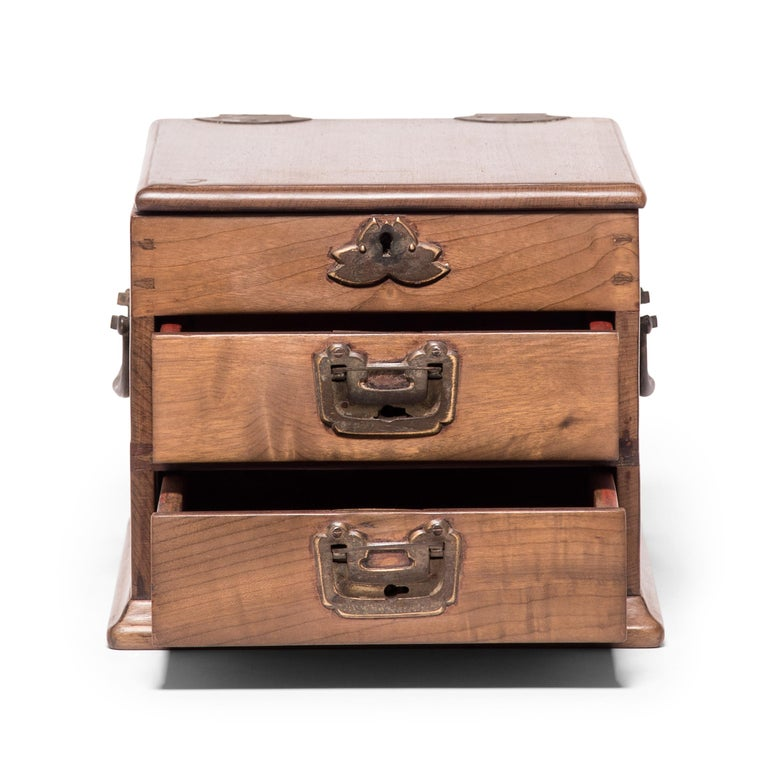 Made circa 1900 in Jiangsu province, this jewelry chest is ornamented with handmade brass hardware and was once used by a woman to contain her personal treasures in the intimate quarters of her traditional Chinese home. The top drawer has a