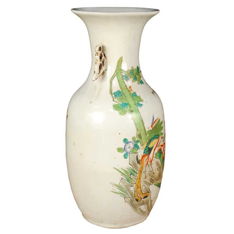 The phoenix tail vase dates from the bronze age and has remained a popular shape for its clean lines and graceful curves. Dating from circa 1900, this vase depicts a peacock in a lovely garden setting. Lavishly detailed and masterfully painted, the