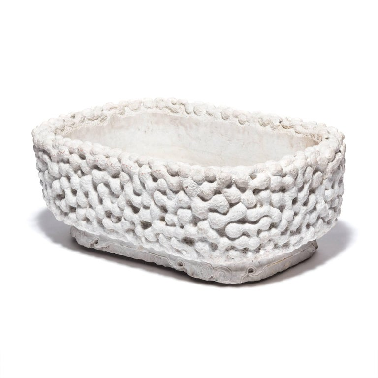 Like Ming scholars' root objects, this hand-carved tub in a gnarled root pattern embraces the Daoist affinities with nature and spontaneity that were widespread throughout China for thousands of years. It was created from a single block of white